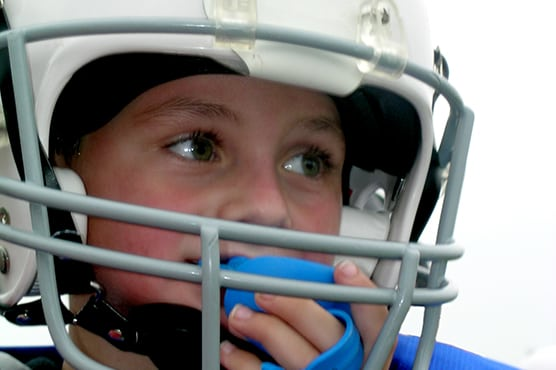 child football player with sports mouthguard from blacman grove dental in murfreesboro