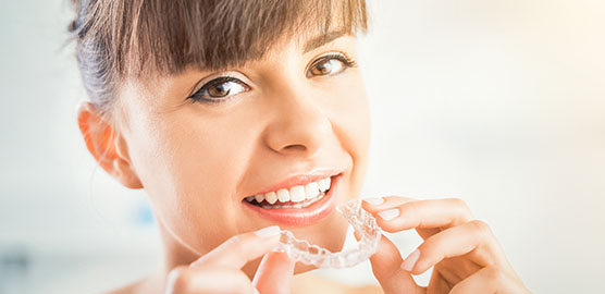woman smiling with clear aligners